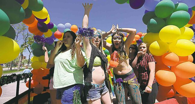 Trevor Hagan / winnipeg free press Pride revellers enjoy the sunshine.