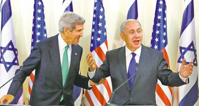 U.S. Secretary of State John Kerry (left) said Sunday, during a visit with Israeli Prime Minister Benjamin Netanyahu, a military strike against Syria remains an option.