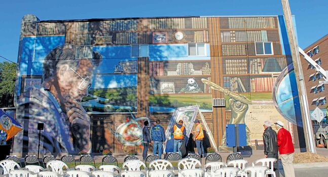 The West End BIZ collaborated with artists Mandy van Leeuwen and Michel Saint Hilaire to create this mural on Ellice and Langside of former mayor Bill Norrie.