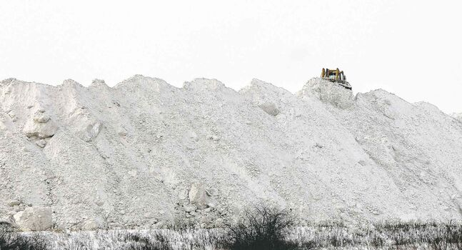The snow mountain at the Snow Disposal Site on Kenaston Blvd. is growing quickly as almost a constant stream of trucks arrive to deliver loads of snow from city streets and parking lots.
