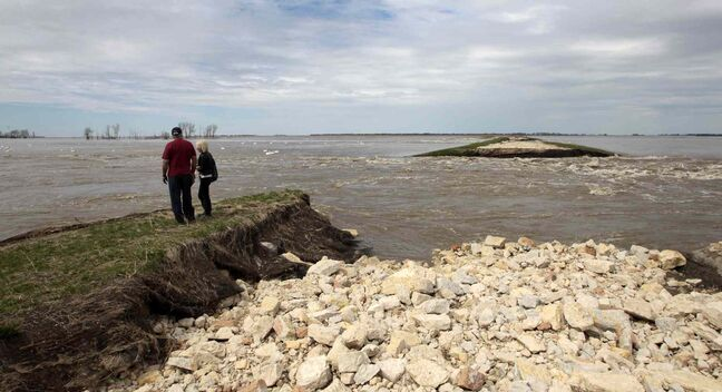 Area farmers check out flooding north of Highway 227 on the west side of the Portage Diversion in 2011.