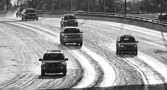Vehicles make their way over the slick Norwood Bridge on Sunday.