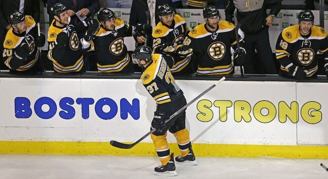 Boston Bruins center Patrice Bergeron (37) is congratulated by teammates after his game-tying goal in the final minute of the third period, forcing overtime against the Toronto Maple Leafs.