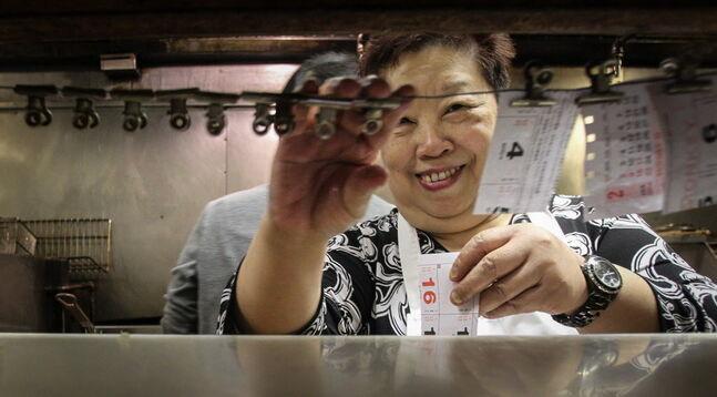 A happy Manyuk Dare organizes orders in Foon Hai's kitchen Monday. The restaurant had been without running water for nearly two months, after the pipes froze.