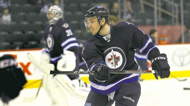 Bryan Little warms up with the team  Thursday at the MTS Centre. His numbers show the Jets centreman is proving his worth.