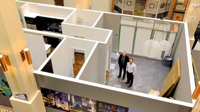 Michael Banman (left) and Doug McKay show off the new Glasshouse Skylofts layout in Cityplace.