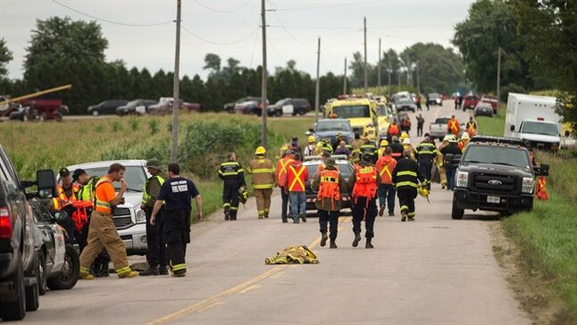 Rescue workers start to pack up Wednesday, August 13, 2014 after finding a 2-year-old girl safe who was missing in a corn field overnight near Centralia, Ontario. The girl went missing Tuesday night after a group of children playing in the field that surrounds a home returned to the residence without her. Family members and neighbours searched the property but weren't able to find the girl so they contacted police. THE CANADIAN PRESS/ Geoff Robins