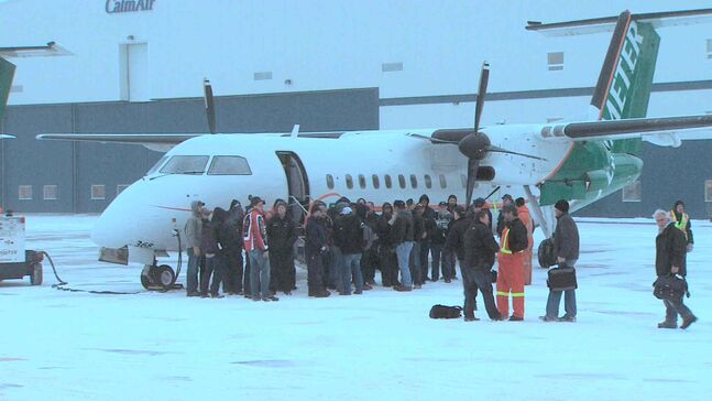 Manitoba Hydro crews prepare to depart for Toronto Tuesday.