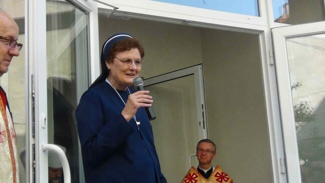 Sister Janice Soluk, of Sisters Servants of Mary Immaculate, speaks at the blessing of the Home of Hope in Ukraine.