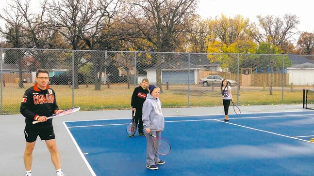 Coun. Brian Mayes (St. Vital) (left) was joined by some neighbourhood kids at the official reopening of the newly-renovated tennis court at Windsor Community Centre in St. Vital on Oct. 19.