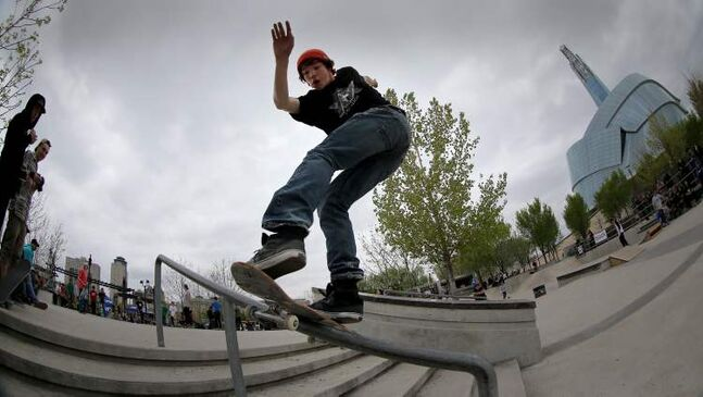 A participant performs a rail slide in the Skate4Cancer skateboarding competition at The Forks Saturday.
