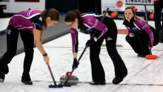 Kristen Foster and Lindsay Titheridge sweep for skip, Chelsea Carey after she throws a rock against Kerri Einarson.  (TREVOR HAGAN/WINNIPEG FREE PRESS)