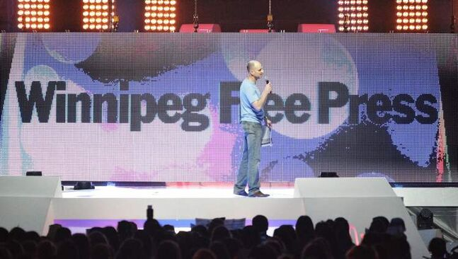 Winnipeg Free Press Editor Paul Samyn talks at We Day at the MTS Centre Tuesday.
