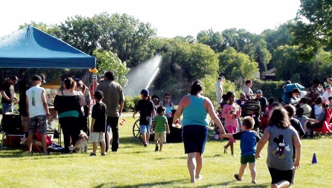 Families enjoyed the Take Pride Elmwood/Canada Day celebration at Ernie O'Dowda Park in 2012.