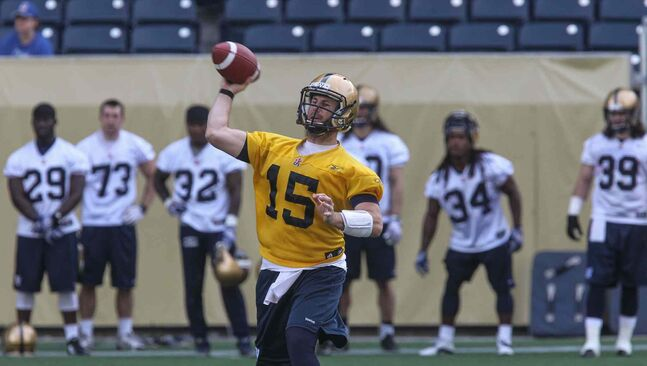 Quarterback Max Hall throws a pass during the first official day of the Winnipeg Blue Bombers training camp at Investors Group Field Sunday morning.