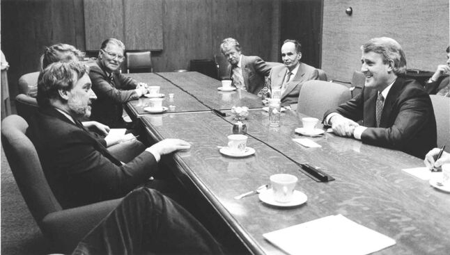 Winnipeg Free Press Editor John Dafoe in boardroom meeting at the Free Press with Brian Mulroney Oct 9 1988 along with editorial staff at the paper.