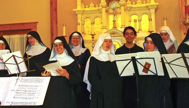 In this Nov. 18, 2013 photo provided by De Montfort Music, a community of nuns sing at a recording sessions for