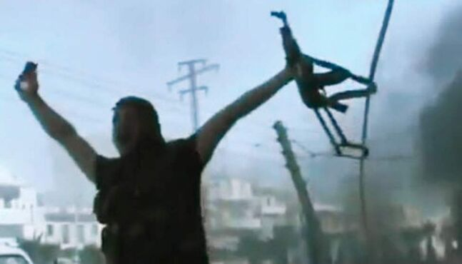 In this image made from amateur video released by the Ugarit News and accessed Monday, a Free Syrian Army soldier reacts during clashes with Syrian government troops in Aleppo, Syria. The Syrian regime acknowledged for the first time Monday that it possessed stockpiles of chemical and biological weapons and said it will only use them in case of a foreign attack and never internally against its own citizens. (AP Photo/Ugarit News via AP video)