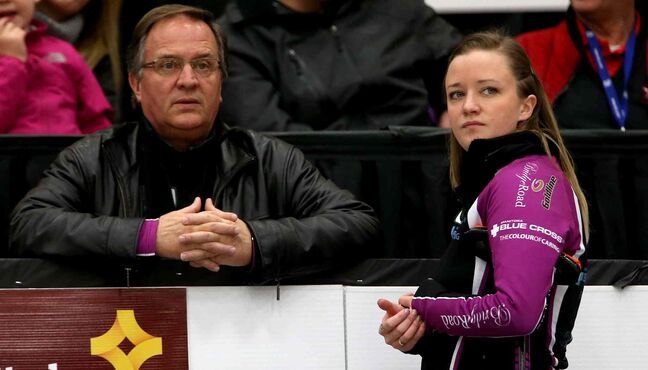 Coach and father, Dan Carey, speaks with Chelsea Carey as she faces Kerri Einarson during the final. (TREVOR HAGAN/WINNIPEG FREE PRESS)