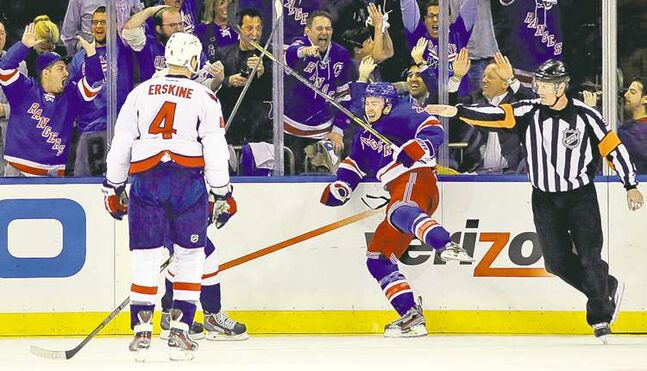 Capitals defenceman John Erskine can only watch as Rangers centre Derek Stepan  celebrates his game-winning goal Monday night in New York City.
