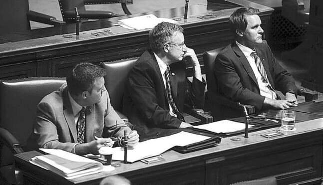 Tory backbenchers Cliff Cullen, Blake Pederson and Cameron Friesen in the legislature on Aug. 14.