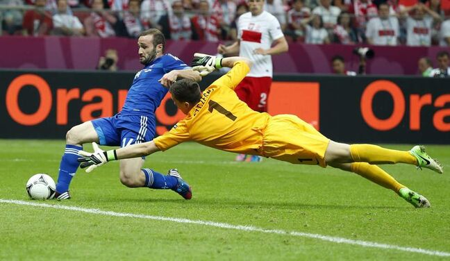 Greece's Dimitris Salpigidis scores past Poland goalkeeper Wojciech Szczesny during the Euro 2012 soccer championship Group A match between Poland and Greece in Warsaw, Poland, Friday, June 8, 2012.