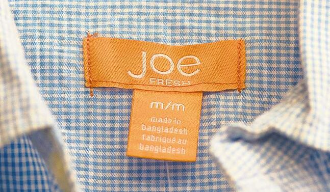 A Joe Fresh garment made in Bangladesh is shown at a Loblaws outlet in Montreal, Thursday, April 25, 2013. Loblaw, the Canadian retailer that sells Joe Fresh clothing, is expressing condolences to the families of victims of a garment factory collapse in Bangladesh.