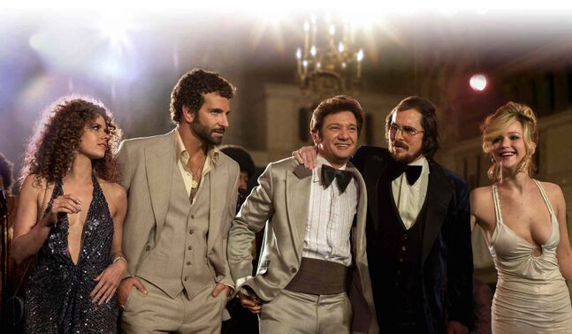 From left, Amy Adams, Bradley Cooper, Jeremy Renner, Christian Bale and Jennifer Lawrence in