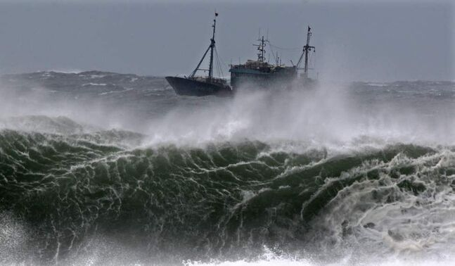 A Chinese fishing boat navigates through rough waves caused by Typhoon Bolaven in waters off Seogwipo on Jeju Island, South Korea, Monday. (AP Photo/Yonhap, Kim Ho-cheon) KOREA OUT