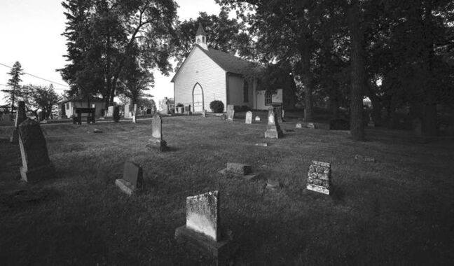 A different view of the cemetery adjacent to the St. James the Assiniboine Anglican Church.