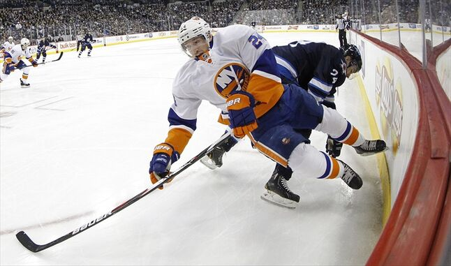 New York Islanders' Brad Boyes is checked by Grant Clitsome during the second period.