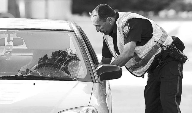 A Winnipeg police officer busts a driver for a traffic violation.