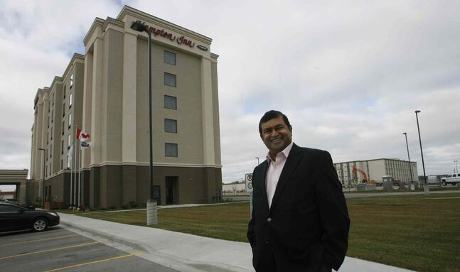 Nizar Mawani of Kothari Developments Inc. at the Hampton Inn by Hilton Winnipeg on Berry Street. This big development is just the start for Manitoba, he says.