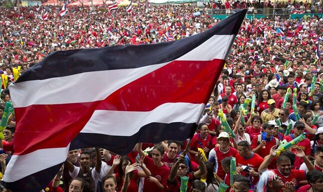 Costa Rica soccer fans gather to watch their team's World Cup round of 16 match against Greece on TV set up in a public square in San Jose, Costa Rica, Sunday, June 29, 2014. (AP Photo/Esteban Felix)