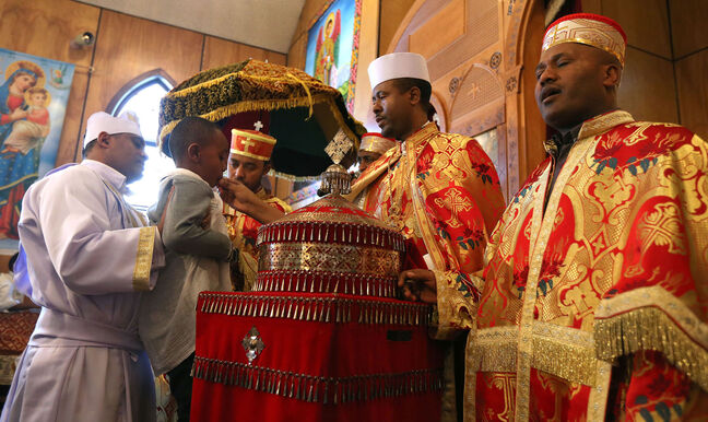 Congregation members receive communion at the Ethiopian Orthodox Church on Mountain Avenue.