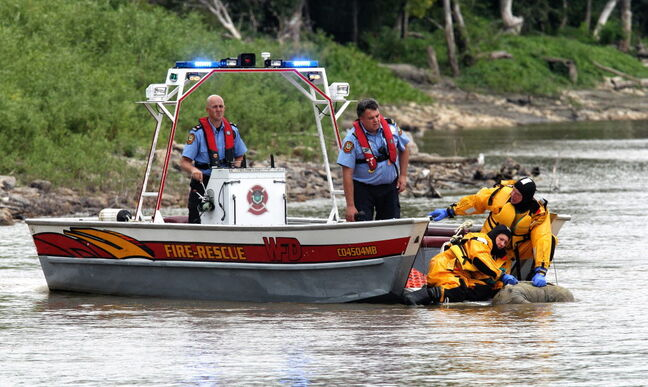 A Winnipeg water rescue crew recovered a body found partially submerged in the Red River just north of the Alexander Docks Sunday afternoon.