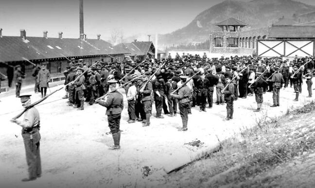 Men under guard at the Cave and Basin internment camp, where Parks Canada opens a new exhibit building on Thursday.