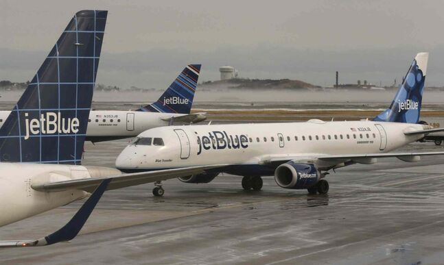 A JetBlue airplane taxis to park at a gate at Logan Airport in Boston in a file photo.