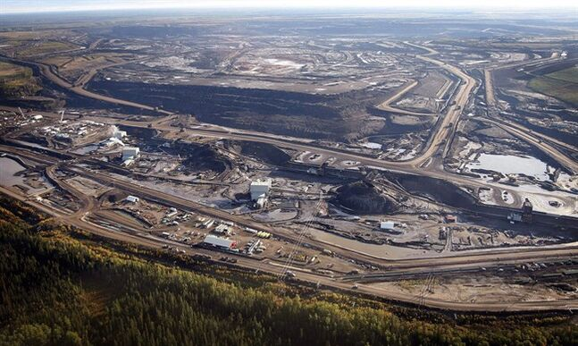 This Sept. 19, 2011 aerial photo shows a oilsands facility near Fort McMurray, Alta. THE CANADIAN PRESS/Jeff McIntosh