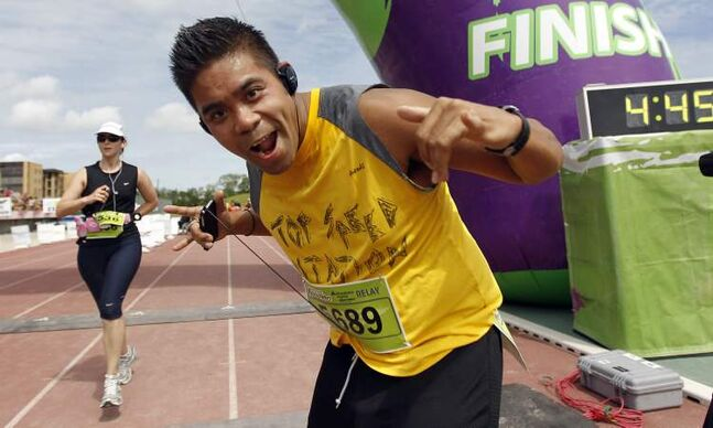 Emil Contreras, a relay participant, crosses the finish line at the University of Manitoba.