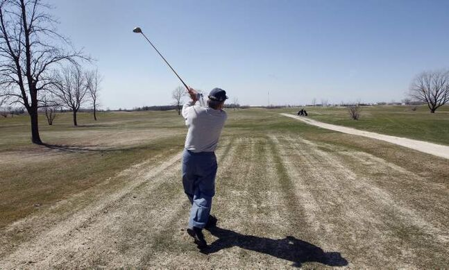 Frank Sclamacis tees off on a round of golf at John Blumberg Golf Course on Monday. The city plans to sell the 27-hole course in Headingley.
