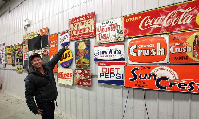 The old signs include ads for soda, ice cream, chocolate bars and cigarettes.