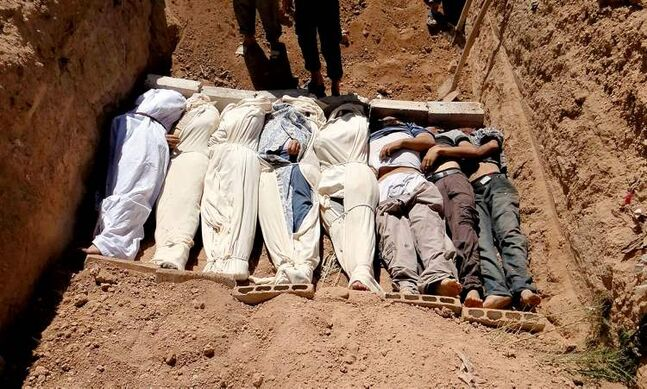 FILE - This image provided by by Shaam News Network on Thursday, Aug. 22, 2013, which has been authenticated based on its contents and other AP reporting, purports to show several bodies being buried in a suburb of Damascus, Syria during a funeral on Wednesday, Aug. 21, 2013. The early-morning barrage against rebel-held areas around the the Syrian capital Damascus immediately seemed different: The rockets made a strange, whistling noise. Seconds after one hit near his home, Qusai Zakarya says he couldn't breathe, and he desperately punched himself in the chest to get air. Hundreds of suffocating, twitching victims flooded into hospitals. Others were later found dead in their homes, towels still on their faces from their last moments trying to protect themselves from gas. Doctors and survivors recount scenes of horror from the alleged chemical attack a week ago.