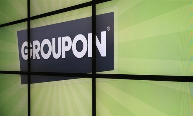 In this Sept. 22, 2012 file photo, the Groupon logo is displayed inside the online coupon company's offices, in Chicago. A law firm pursuing a class-action suit against Groupon over expired deal purchases says the online coupon sharing site has agreed to a settlement of more than $500,000. THE CANADIAN PRESS/AP-Charles Rex Arbogast, File