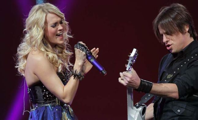 Carrie Underwood and her guitar player rock the MTS Centre.