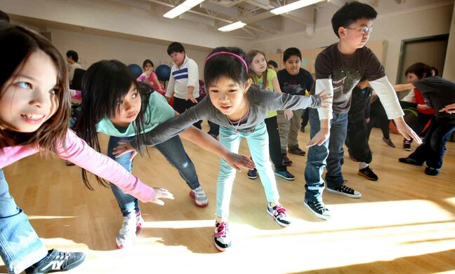 Grade 3 students from Greenway School do yoga and other activities during indoor recess when frigid weather keeps them inside.