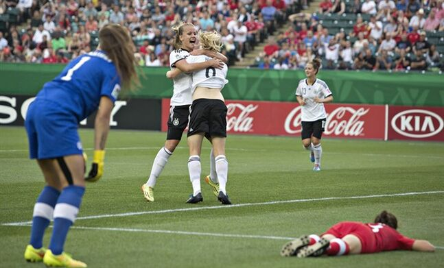 Canada goalkeeper Kailen Sheridan (1) and Jessie Fleming (8) react to a goal as Germany's Pauline Bremer (9) and Lena Petermann (18) celebrate during first half action of the FIFA U-20 Women's World Cup quarter-finals in Edmonton, Alta., on Saturday August 16, 2014. THE CANADIAN PRESS/Jason Franson