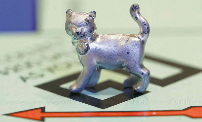Looking for the iron? Maybe Monopoly's new cat token ate it.