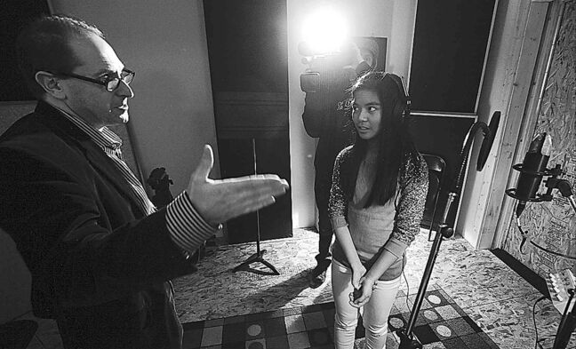Nowack  speaks with  Maria Aragon during a recent recording  session  in Winnipeg.