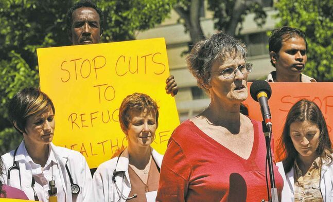 Karin Gordon of the Hospitality House Refugee Ministry speaks at a recent protest of the feds' stance on refugee benefits.